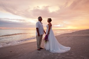 bride and groom at sunset silhouette on sanibel island