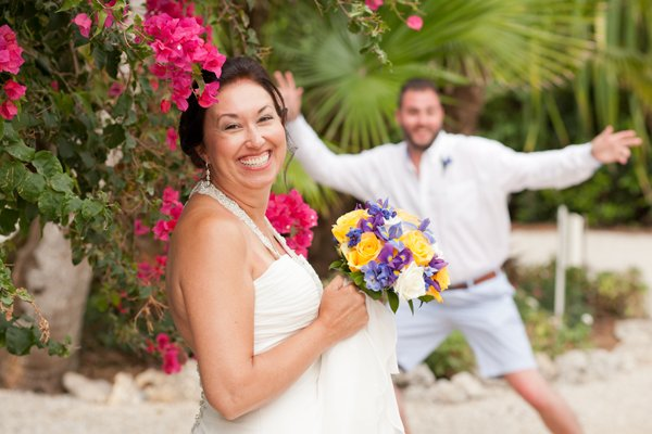 Bride portrait with son making a photo bomb